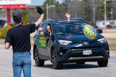 Justin Corrente of Oxford waves to well wishers during a parade in his honor.
