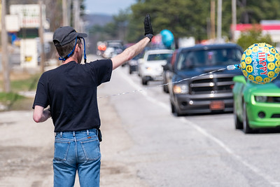Justin Corrente of Oxford waves to well wishers during a parade in his honor. Nearlt 100 vehicles, including 10 fire trucks and five police cars, and 300 supporters participated in the parade.