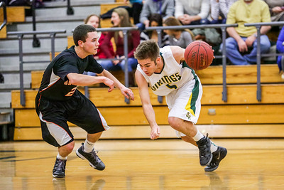 Matt Beauchesne drives against Brunswick's Derek Devereaux.