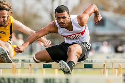 Lisbon's Charles Adams on his way to a first place finish in the 110 meter hurdles on Thursday at the Guoin complex in South Paris.