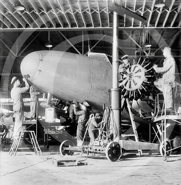 Commercial aircraft being serviced 1944.