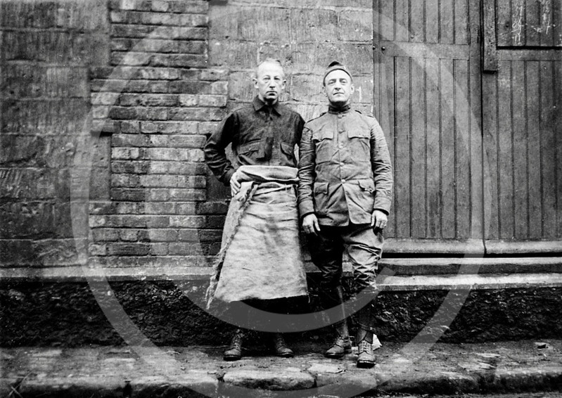 Lieut. Vincent T. Coughlin, of New York and Frank Hanley of the Armored Cavalry Regiment (ARC) at warehouse #6 in Paris shipping Christmas cheer to the American Expeditionary Forces (AEF) 25 February 1919.