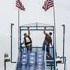 Photo by Greg Eans, Messenger-Inquirer.com | geans@messenger-inquirer.com<br /> <br /> Francisco Galindo, left, and David Welch with Casey's Rides out of Utica assemble the roof of the patriotic sliding board ride Thursday before the start of the 41st Annual International Bar-B-Q Festival in Downtown Owensboro. The festival kicks off its opening ceremonies at 5 p.m. Friday at McConnell Plaza.