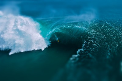 big wave surfing at teahupoo