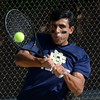 Detroit Country Day's Michael Khaghany hits a backhand during his No. 1 singles final match against Cranbrook's Benji Jacobson on Thursday. (MIPrepZone photo by Jason Schmitt)