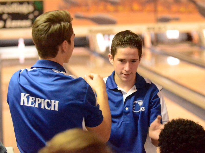 Ortonville-Brandon's Jeremiah Turner (right) celebrates with teammates Saturday at Astro Lanes in Madison Heights. Turner won the Oakland County individual championship after firing a 729 series. (MIPrepZone photo by Jason Schmitt)