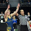 Walled Lake Central senior Ben Freeman looks to the crowd to celebrate state title No. 4 Saturday night at The Palace of Auburn Hills. Freeman beat Birmingham Groves' Colin Takata in the 140-pound championship match, 24-7. (MIPrepZone photo by Jason Schmitt)