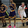 Brady Flynn (right), Birmingham Seaholm, celebrates a hard fought victory as Dominic Kejbou (10) and Ty Bland, Auburn Hills Avondale, walk off the court following a 54-48 loss to the Maples during district semifinal basketball action at Bloomfield Hills High School Wednesday, March 8, 2017. 2017. Flynn also scored a game high 22 points in the winning effort. 2017. (MIPrepZone photo / LARRY McKEE)