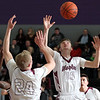 Zach Ziegler (10) and Brady Flynn, Birmingham Seaholm, go up for a rebound during district semifinal basketball action against Auburn Hills Avondale at Bloomfield Hills High School Wednesday, March 8, 2017. 2017. Seaholm defeated the Yellowjackets 54-48. (MIPrepZone photo / LARRY McKEE)
