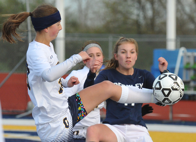 Oxford's Alexa Schramm (L) gets a leg up on Berkley's Karsen Murray during the OAA White match played on Monday May 1, 2017 at Oxford HS.  The Wildcats and Bears played to a scoreless draw.  (MIPrepZone photo by Ken Swart)