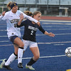 Berkley's Caroline Tripp (2) tries to hold off Oxford's Mackenzie Eschberger (21) during the OAA White match played on Monday May 1, 2017 at Oxford HS.  The Bears and Wildcats played to a scoreless draw.  (MIPrepZone photo by Ken Swart)