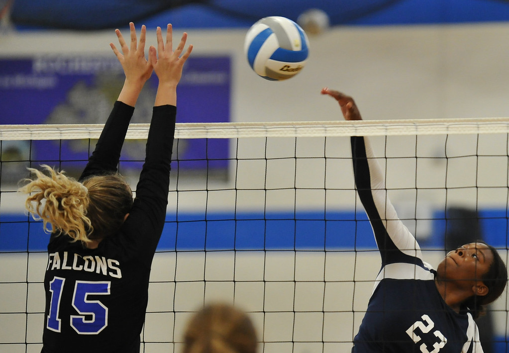 . Berkley\'s Erin High (23) looks to put her hit past Rochester\'s Rachel Gilbert (15) during the match played on Tuesday September 19, 2017 at Rochester HS.  The Falcons defeated the Bears in straight sets 25-20, 25-13, 25-18.  (Oakland Press photo by Ken Swart)