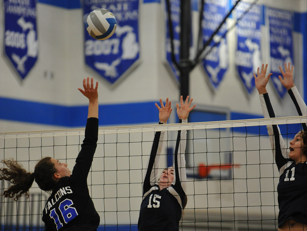 . Rochester\'s Kaitlyn Kennedy (16) hits the ball over the block attempt of Berkley\'s Alissa McBride (15) and Zoe Knaus (11) during the match played on Tuesday September 19, 2017 at Rochester HS.  The Falcons defeated the Bears in straight sets 25-20, 25-13, 25-18.   (Oakland Press photo by Ken Swart)