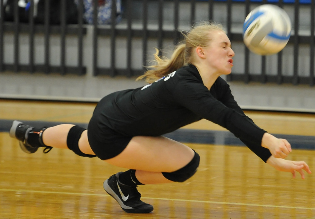 . Rochester\'s Sailor Mayes makes a diving dig in the OAA White match against Berkley.  The Falcons defeated the Bears in straight sets 25-20, 25-13, 25-18 in the OAA White match played on Tuesday September 19, 2017 at Rochester HS.  (Oakland Press photo by Ken Swart)