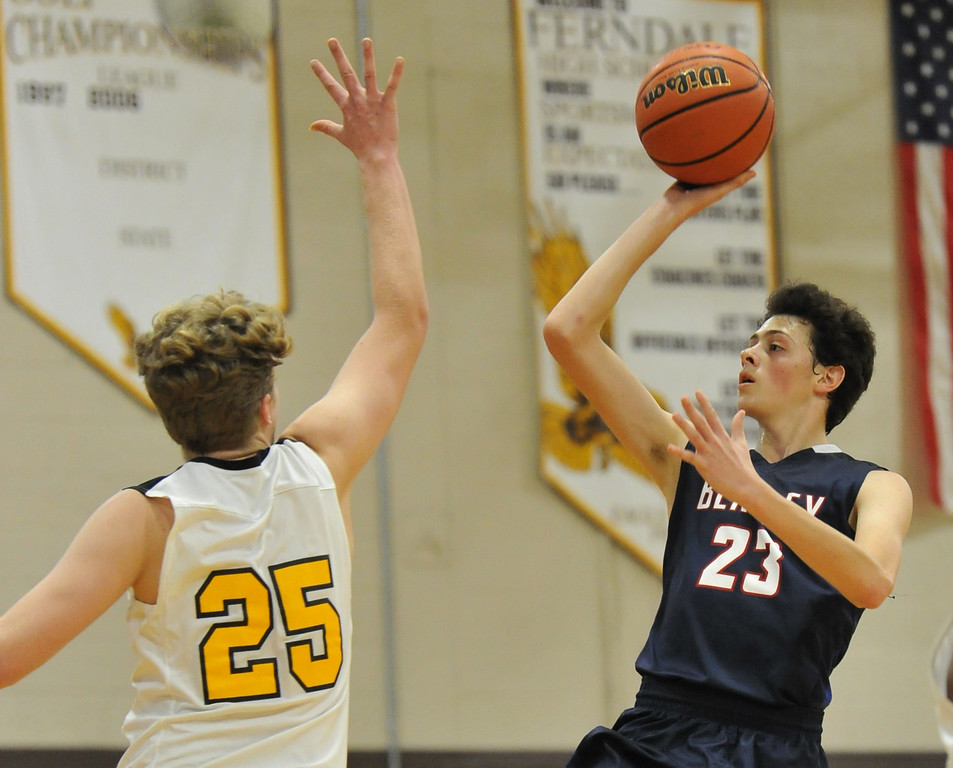 . Berkley\'s Corey Zimmerman (23) shoots over Ferndale\'s Brian Pozolo for two of his game high 23 points in the OAA Blue match up played on Thursday January 11, 2018 at Ferndale HS.  The Bears defeated the Eagles 54-49.  (Oakland Press photo by Ken Swart)