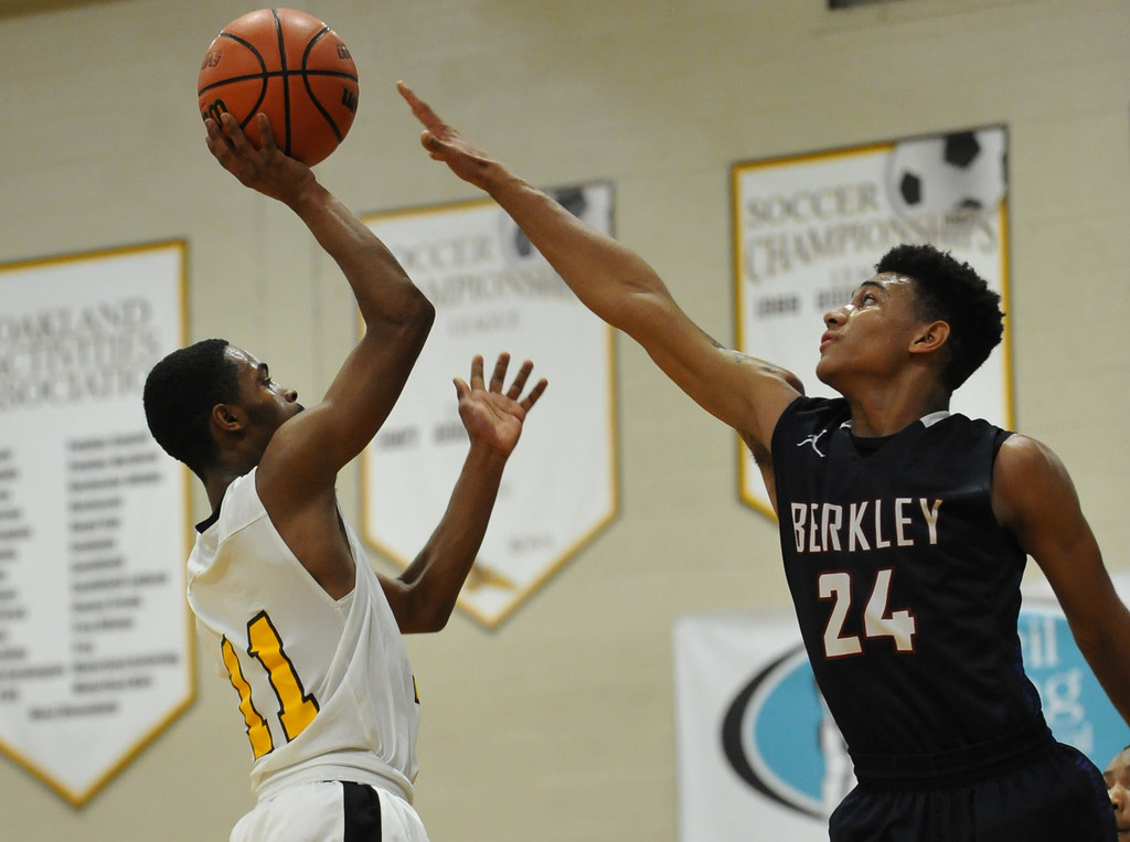 . Berkley\'s Greg McGee (24) stretches to block the shot attempt of Ferndale\'s Tim Seaton during the OAA Blue match up played on Thursday January 11, 2018 at Ferndale HS.  The Bears defeated the Eagles 54-49.  (Oakland Press photo by Ken Swart)