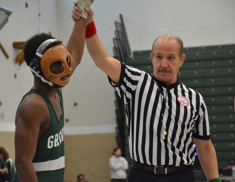 The masked Khalil Ford of Birmingham Groves gets his hand raised in vitory after defeating Troy's Hansen Wang in the 140-pound class. South Lyon, Southfield A&T, Troy, Walled Lake Northern and Orchard Lake St. Mary's were among teams competing Saturday at the Birmingham Groves Super Duals wrestling tournament. (MIPrepZone photo gallery by MARVIN GOODWIN).