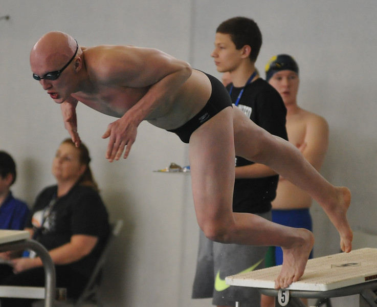 Brother Rice's Patrick Olmstead leaps from the starting block at the Oakland County swimming championships. (MIPrepZone photo by KEN SWART).