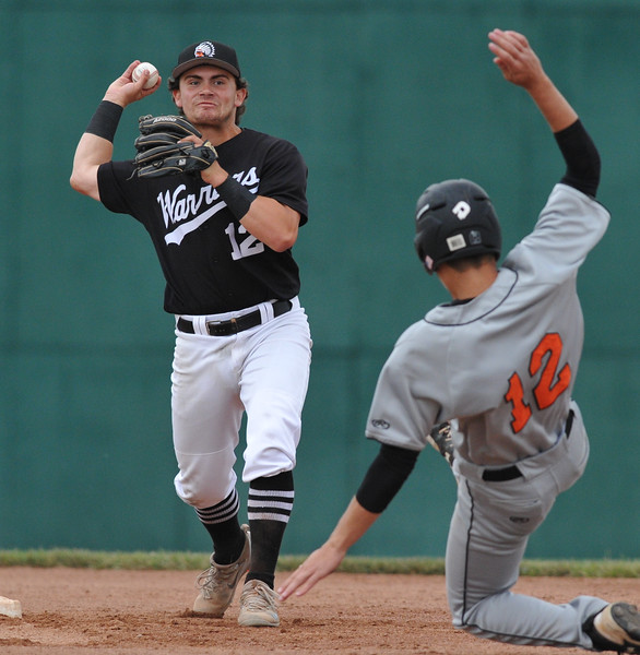 Brother Rice's JD Allen turns the double play as Northville's Trevor Shornack tries to break up the play during the MHSAA D1 baseball quarterfinal played on Tuesday June 12, 2018 at Wayne State University.  The Warriors defeated the Mustangs 9-2.  (Oakland Press photo by KEN SWART)
