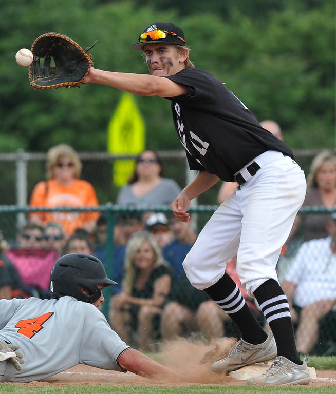 . Brother Rice first baseman Mac Menard awaits the pickoff throw as Northville\'s Steven Morrissey dives back safely during the MHSAA D1 baseball quarterfinal played on Tuesday June 12, 2018 at Wayne State University.  The Warriors defeated the Mustangs 9-2.  (Oakland Press photo by KEN SWART)