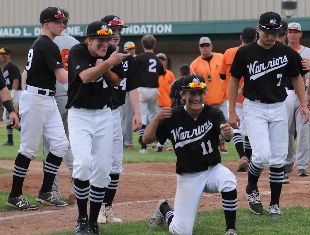 . Birmingham Brother Rice celebrates their 9-2 D1 quarterfinal win over Northville that was played on Tuesday June 12, 2018 at Wayne State University. (Oakland Press photo by KEN SWART)
