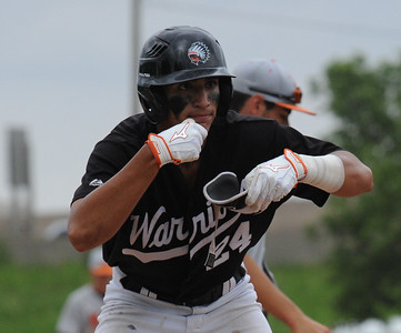 Brother Rice's Tito Flores celebrates his base clearing triple  in the sixth inning of the MHSAA D1 baseball quarterfinal against Northville played on Tuesday June 12, 2018 at Wayne State University.  The Warriors defeated the Mustangs 9-2.  (Oakland Press photo by KEN SWART)