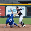 Birmingham Brother Rice's Tyler Sarkisian looks to turn the double play as Detroit Catholic Central's Matt Harding tries to break it up during the second inning of the Catholic League A-B title game Friday at Jimmy John's Field in Utica. (MIPrepZone photo by Jason Schmitt)
