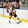 Birmingham Brother Rice senior Michael McInerney surveys the ice after crossing the blue line during the second period Wednesday night. McInerney scored a goal in his team's 5-2 win over St. Mary's. (MIPrepZone photo by Jason Schmitt)
