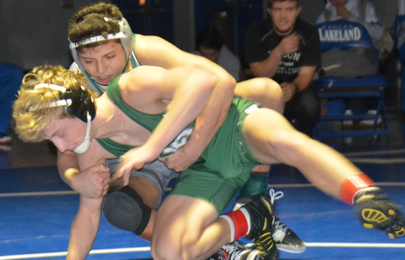 Anthony Gonzales of Waterford Kettering has a firm grip on Lake Orion's Noah Smith in their 140-pound match, won by Gonzales. Kettering featured seven finalists as the Captains won the Lakeland Invitational wrestling tournament Saturday at Lakeland High. Kettering won with 250.5 points and Trenton, Lake Orion, Durand, Lakeland, Novi and Walled Lake Northern followed. (MIPrepZone photo gallery by MARVIN GOODWIN).