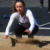 Holly's Elena Garza competes in the long jump. Novi Detroit Catholic Central won the boys title and Macomb Lutheran North was a winner on the girls side of the Tri-County Invitational track and field meet Saturday at Ortonville Brandon High School. (MIPrepZone photo gallery by MARVIN GOODWIN).