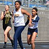 Detroit Country Day's Destini Lewis takes the baton from Skyler Ways on the 4 x 800 relay. Novi Detroit Catholic Central won the boys title and Macomb Lutheran North was a winner on the girls side of the Tri-County Invitational track and field meet Saturday at Ortonville Brandon High School. (MIPrepZone photo gallery by MARVIN GOODWIN).