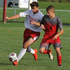 Lutheran High Northwest's Matthew Giannetti (L) tries to move around  Clarenceville's Joseph Sanchez (6) during the match played on Wednesday September 7, 2016 at LHNW.  The Crusaders lost to the Trojans 1-0. (MIPrepZone photo by Ken Swart)