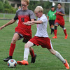 Lutheran High Northwest's Joe Ennis (R) makes a move around Clarenceville's Alexander Immonen (18) during the match played on Wednesday September 7, 2016 at LHNW.  The Crusaders lost to the Trojans 1-0. (MIPrepZone photo by Ken Swart)