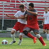 Lutheran High Northwest's Jack Crandall (L) battles with Clarenceville's Jesus Gonzalez (R) during the match played on Wednesday September 7, 2016 at LHNW.  The Crusaders lost to the Trojans 1-0. (MIPrepZone photo by Ken Swart)