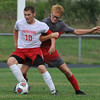 Lutheran High Northwest's Joe Albus (10) is held up by Clarenceville's Alexander Immonen during the match played on Wednesday September 7, 2016 at LHNW.  The Crusaders lost to the Trojans 1-0. (MIPrepZone photo by Ken Swart)