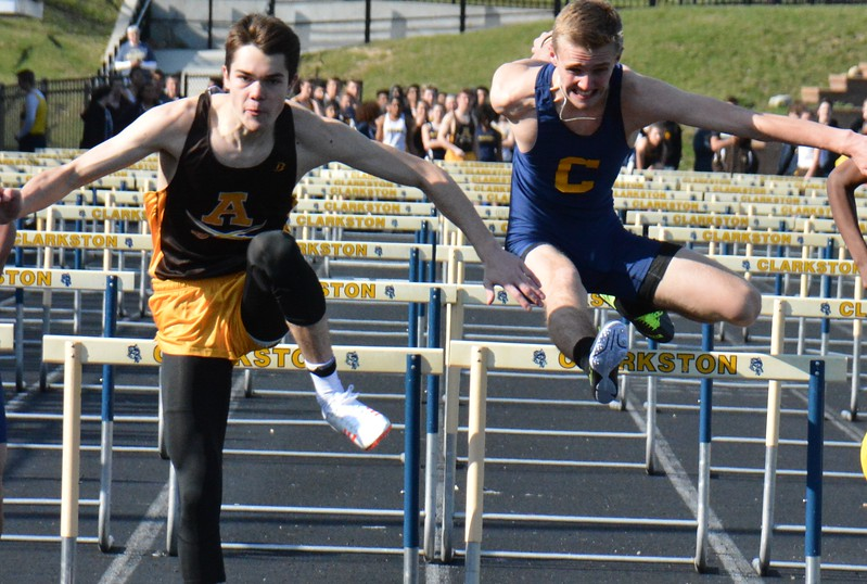 Lukas Adgate (left) of Rochester Adams) skims the last hurdle ahead of Clarkston's Donovan Tolbert in the 110-meter high hurdles. Rochester Adams visited Clarkston for an OAA Red dual track and field meet and each squad came away with victories. Adams's girls got a rare victory over the Wolves and Clarkston's boys were triumphant. (MIPrepZone photo gallery by MARVIN GOODWIN).
