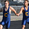 Clarkston's Grant Telfer (left) takes the baton from Dalton Sampson in the 4 x 800 relay, won by the Wolves. Rochester Adams visited Clarkston for an OAA Red dual track and field meet and each squad came away with victories. Adams's girls got a rare victory over the Wolves and Clarkston's boys were triumphant. (MIPrepZone photo gallery by MARVIN GOODWIN).