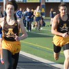 Ben Urbano (left) of Rochester Adams wins the 400 dash. Rochester Adams visited Clarkston for an OAA Red dual track and field meet and each squad came away with victories. Adams's girls got a rare victory over the Wolves and Clarkston's boys were triumphant. (MIPrepZone photo gallery by MARVIN GOODWIN).