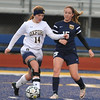 Oxford's Grace Brenner (14) controls the ball in front of Clarkston's Kristin Bouchard (15) during the match played on Tuesday April 11, 2017 at Oxford HS.  The Wildcats and Wolves played to a 1-1 draw.  (MIPrepZone photo by Ken Swart)