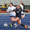 Clarkston's Caylee Ludwig (23) puts a shot on goal as Oxford's Emma Gordon (2) defends during the match played on Tuesday April 11, 2017 at Oxford HS.  The Wolves and Wildcats played to a 1-1 draw.  (MIPrepZone photo by Ken Swart)