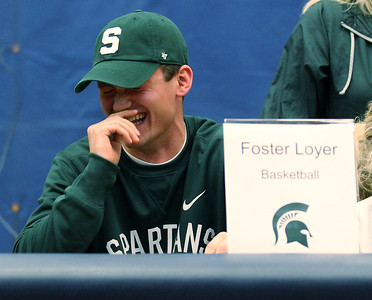 Foster Loyer has a lighter moment during national signing day ceremonies at Clarkston High School Wednesday, Nov. 8, 2017. Loyer signed his National Letter of Intent to attend Michigan State University next season. (For The Oakland Press / LARRY McKEE)