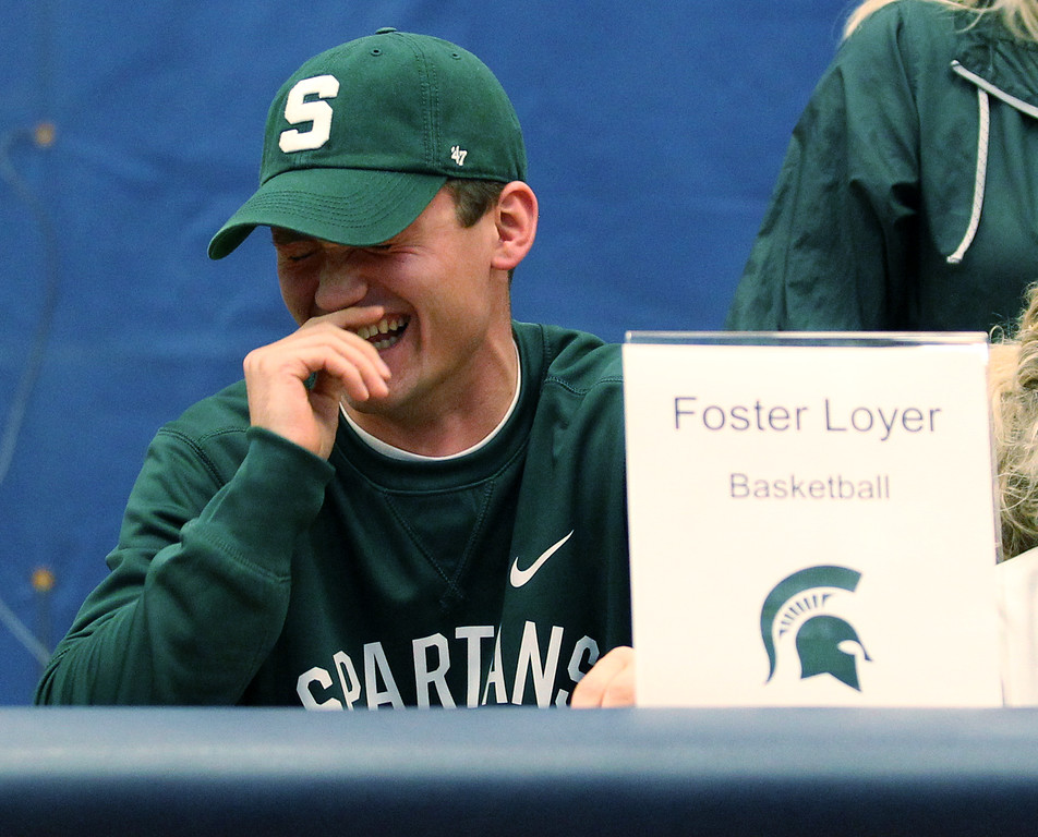 . Foster Loyer has a lighter moment during national signing day ceremonies at Clarkston High School Wednesday, Nov. 8, 2017. Loyer signed his National Letter of Intent to attend Michigan State University next season. (For The Oakland Press / LARRY McKEE)