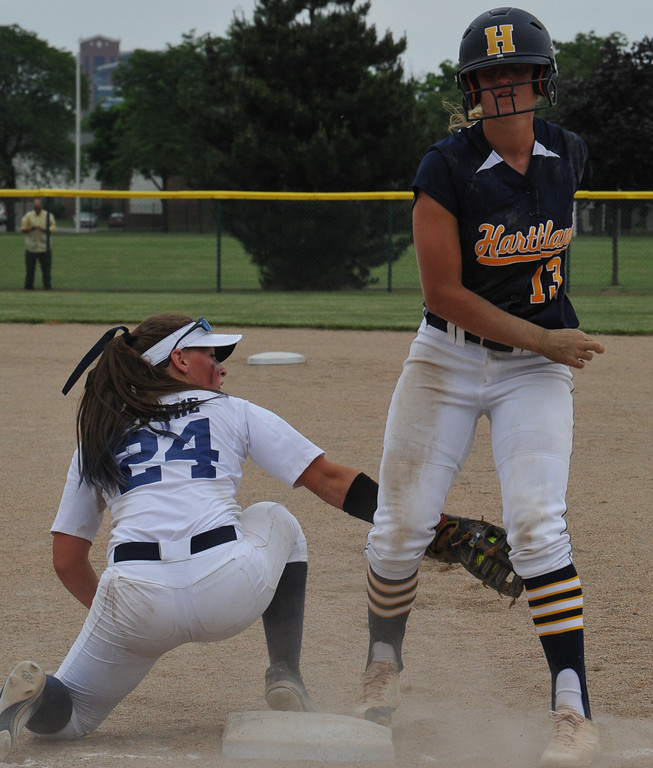 . Clarkston first baseman Abbey Tolmie (24) tries for the pickoff of Hartland\'s Madelin Skene (13) during the MHSAA D1 Softball Quarterfinal game played on Tuesday June 12, 2018 at Wayne State University.  The Wolves lost to the Eagles 3-2.  (Oakland Press photo by KEN SWART)