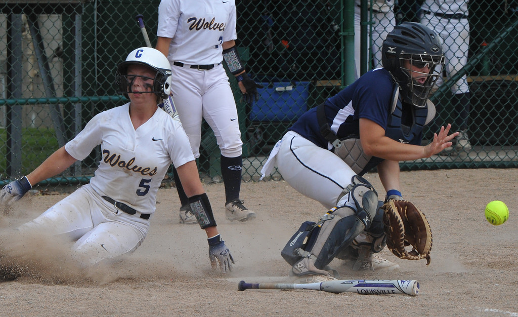 . Clarkston\'s Paige Blevins (5) scores the Wolves 2nd run behind Hartland catcher Brooke Cowan during the MHSAA D1 Softball Quarterfinal game played on Tuesday June 12, 2018 at Wayne State University.  The Wolves lost to the Eagles 3-2.  (Oakland Press photo by KEN SWART)