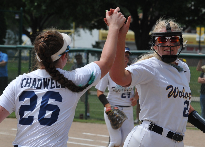Clarkston pitcher Olivia Warrington (R) celebrates a strikeout with teammate Hannah Chadwell (26) during the MHSAA D1 Softball Quarterfinal game against Hartland played on Tuesday June 12, 2018 at Wayne State University.  The Wolves lost to the Eagles 3-2.  (Oakland Press photo by KEN SWART)