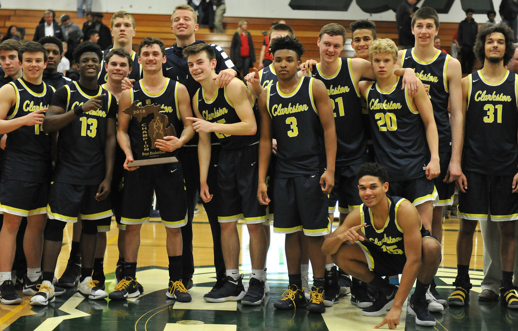 . The Clarkson Wolves celebrate their 58-35 win over Orchard Lake St Marys to win the Class A Regional Final held on Wednesday March 14, 2018 at West Bloomfield HS.  (Oakland Press photo by Ken Swart)