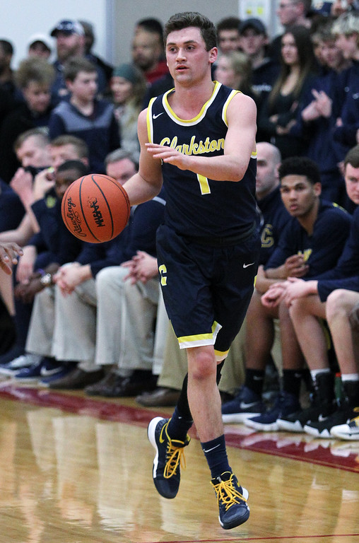 . Clarkston defeats Flint Carman-Ainsworth 52-31 in Class A quarterfinal basketball action at Grand Blanc High School Tuesday, March 20, 2018. (For The Oakland Press / LARRY McKEE)