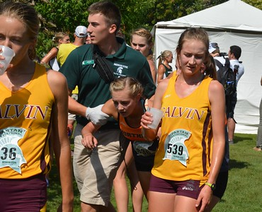 Kathleen Colvin of Ohio Northern is assisted by an MSU staffer after the finish.