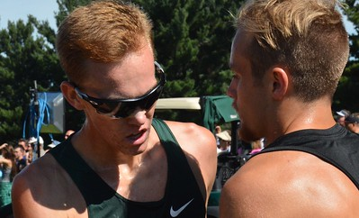 Ryan Robinson (left) of Michigan State recovers after the race.