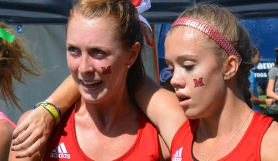 A pair of Miami (Ohio) runners share the pain of the finish.